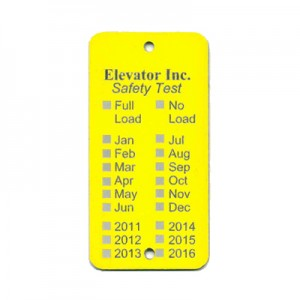 yellow elevator tag with months and years