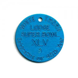 radial text stamped tag