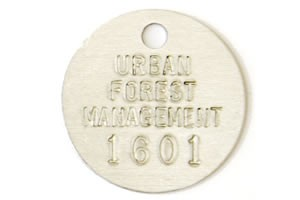 round stamped tree tag