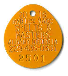 large orange oval rabies tag