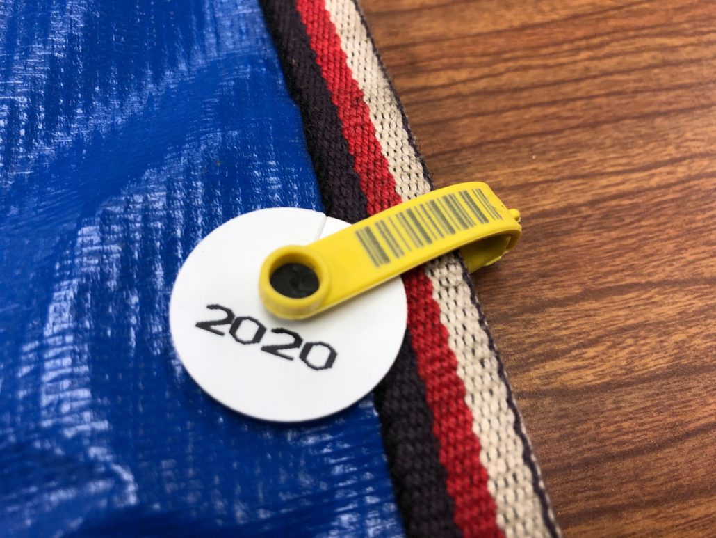 plastic apron tag and year disc
