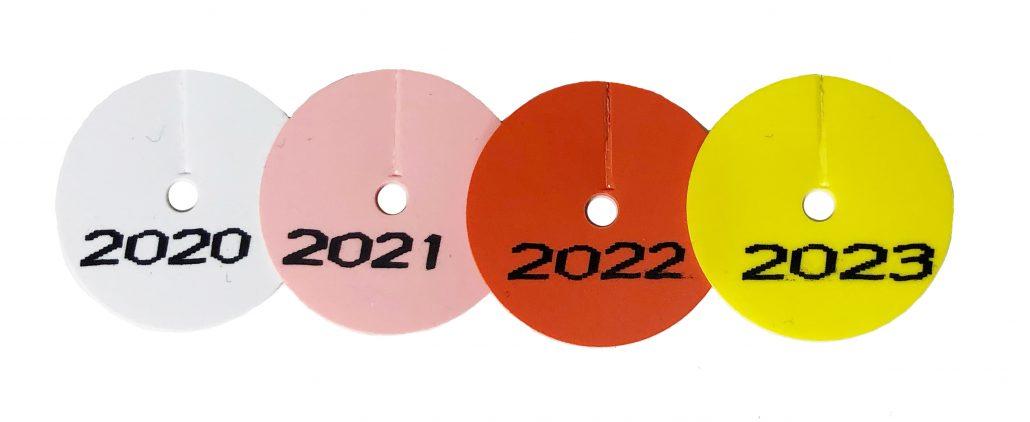 apron tag year discs