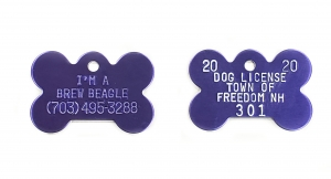 purple aluminum tag with white paint fill. Bone shaped dog tags